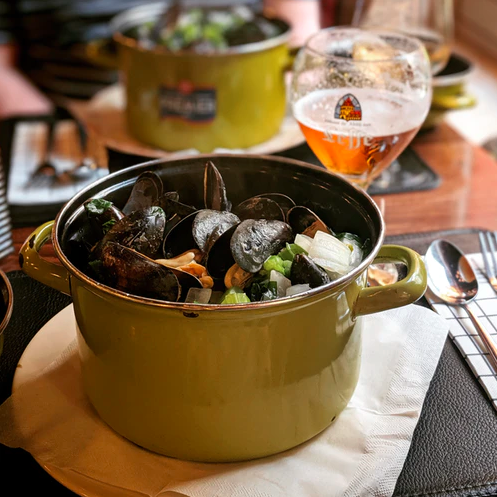 Mussels in a Dutch Oven on a table