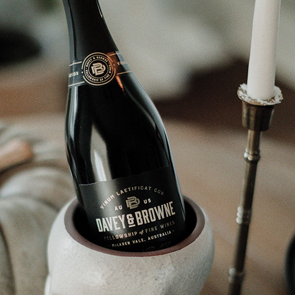 Davey Browne Black Bubbles bottle next to a candlestick