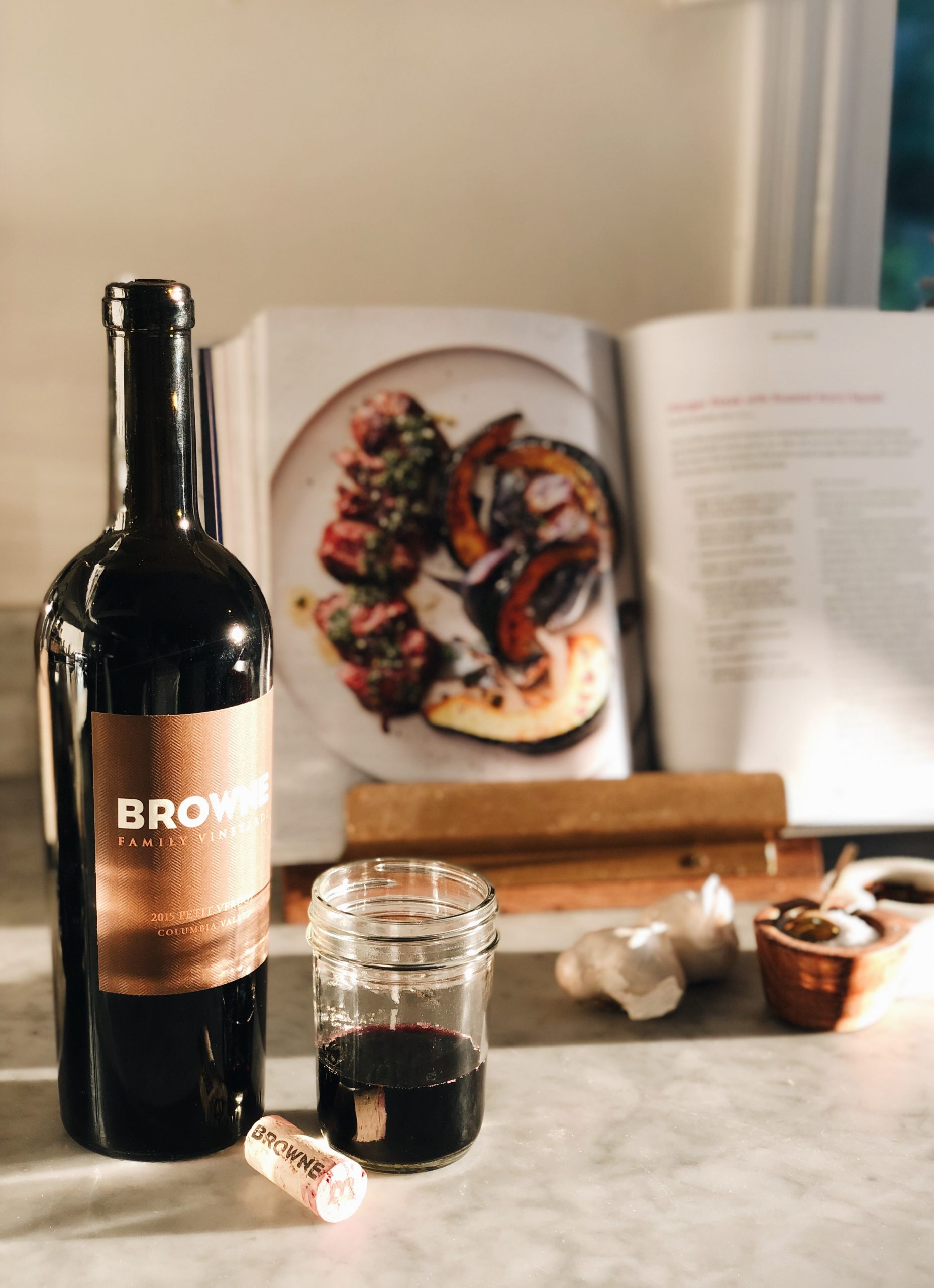 Browne Pinot Noir and open cookbook on counter
